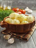 pic of saucepan  - Potatoes with dill in a saucepan on the table - JPG