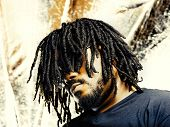 stock photo of dreadlock  - cool african guy with dreadlocks - JPG