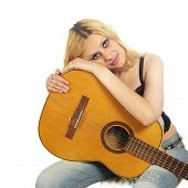 closeup portrait of young woman with guitar