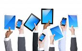 Business Hands Holding Electronic Devices