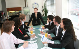 picture of business meetings  - image of a young executive woman leading a business meeting - JPG