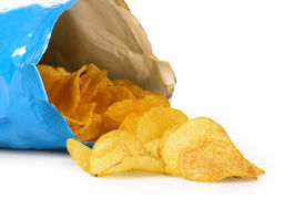 foto of doritos  - potato chips in a torn box on an isolated white background - JPG