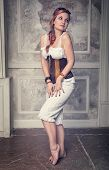 foto of minx  - Beautiful steampunk woman with pink hair posing - JPG