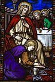 stock photo of magdalene  - A Victorian stained glass window depicting Saint Mary Magdalen annointing the feet of Jesus Christ and washing them with her hair - JPG