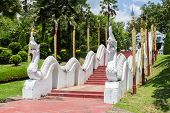 picture of garden sculpture  - the white naga sculpture on staircase rail in the garden - JPG