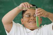 stock photo of tween  - Hispanic boy in science class - JPG