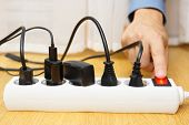 stock photo of electric socket  - energy savings with turning off electrical appliances - JPG