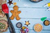 picture of gold panning  - Table view of decorating Christmas gingerbread man cookie - JPG
