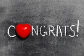 picture of congrats  - congrats exclamation handwritten on blackboard with heart symbol instead of O - JPG