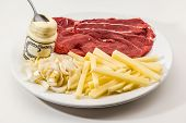 picture of chicory  - Raw Drierib steak and fries with chicory and mayonnaise - JPG
