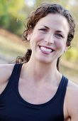 picture of athletic woman  - Fit athlete with big smile exercising in black tank top - JPG