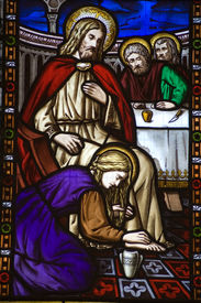 image of magdalene  - A Victorian stained glass window depicting Saint Mary Magdalen annointing the feet of Jesus Christ and washing them with her hair - JPG