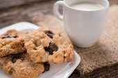 stock photo of chocolate-chip  - Studio Shot of Stack of Chocolate chip cookie and glass of milk - JPG