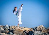 stock photo of karate-do  - Young girl training karate  - JPG