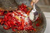 stock photo of pestle  - Making sambal - JPG