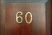 stock photo of numbers counting  - Number sixty on a wooden entrance door - JPG