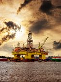 stock photo of  rig  - Oil rig moored in the harbor against a dramatic sky - JPG