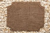pic of stitches  - Frame made of burlap with stitches and place for your text lying on pumpkin seeds as a background - JPG