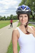 stock photo of inline skating  - A Roller skating girl in park rollerblading on inline skates - JPG