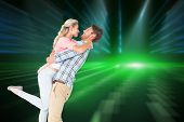 stock photo of pick up  - Handsome man picking up and hugging his girlfriend against cool nightlife lights - JPG