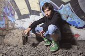 stock photo of runaway  - A teen made some graffiti on the wall of a tunnel - JPG