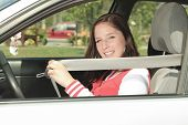 foto of car-window  - Car driver woman happy showing car keys out window - JPG