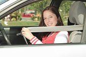 foto of car-window  - Car driver woman happy showing car keys out window - JPG