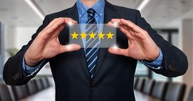 picture of check  - Businessman holding five star rating  - JPG