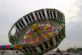 stock photo of amusement park rides  - Spinning ride at the county fair - JPG