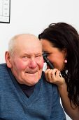 stock photo of eardrum  - Happy patient at the otolaryngology making fun with doctor during examination - JPG