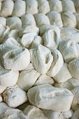 stock photo of home-made bread  - Freshly made bread dough on a tray showing rolls ready to be baked - JPG