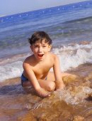 picture of preteens  - preteen handsome boy swimming on the red sea beach - JPG