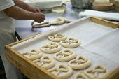foto of pretzels  - A baker making a fresh Pretzel Dough on a baker - JPG