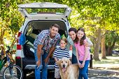 pic of road trip  - Happy family getting ready for road trip on a sunny day - JPG