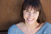 foto of close-up middle-aged woman  - Close up portrait of a smiling middle aged woman - JPG