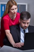 stock photo of inappropriate  - Office worker harassed by sexy female chief - JPG