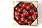 pic of wooden crate  - macro photographed in daylight red tomatoes in wooden crate - JPG