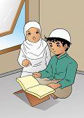 stock photo of muslim  - Asian muslim boy is reading koran with his mother - JPG