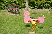 image of playground  - Pink toy and bench on playground in park - JPG