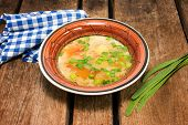 stock photo of green onion  - cabbage soup with green onions on the plank table - JPG