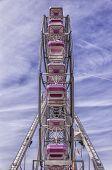 stock photo of funfair  - A traditional ferris wheel at a local carnival funfair - JPG