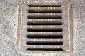 stock photo of manhole  - Swedish Manhole cover close up with asphalt around it - JPG