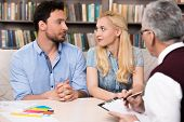 picture of psychologist  - Young couple talking with psychologist - JPG