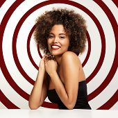 picture of afro hair  - happy smiling black woman with a round on a back and afro hair - JPG