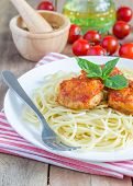 image of meatball  - Meatballs in tomato sauce with spaghetti on a white plate - JPG