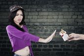 foto of teen smoking  - Portrait of teenage girl rejecting to take cigarette and refuse to smoke - JPG