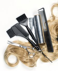 picture of hair comb  - Shiny blond hair with hair cutting shears and comb isolated on white - JPG