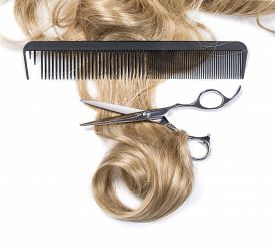 stock photo of hair comb  - Shiny blond hair with hair cutting shears and comb isolated on white - JPG