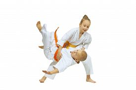 stock photo of judo  - The girl is throwing the boy throw judo - JPG