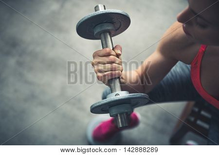 poster of Closeup On Fitness Woman Workout With Dumbbell In Urban Loft Gym